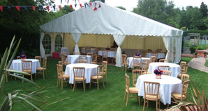Marquee in Garden Party with tables