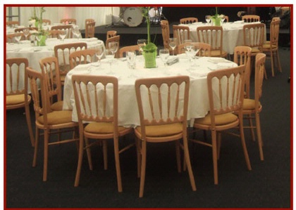 Wooden Banquet Chairs around Table